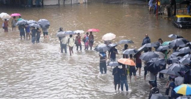 Rains stop Mumbai in tracks, commuters hit as trains cancelled