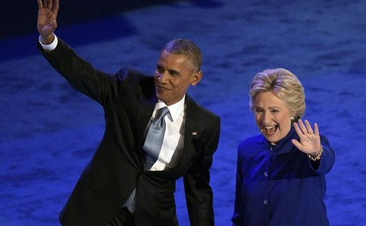 Embracing Clinton, Obama says she'll 'finish the job'
