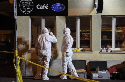 2 killed in shooting at Swiss café, attackers at large