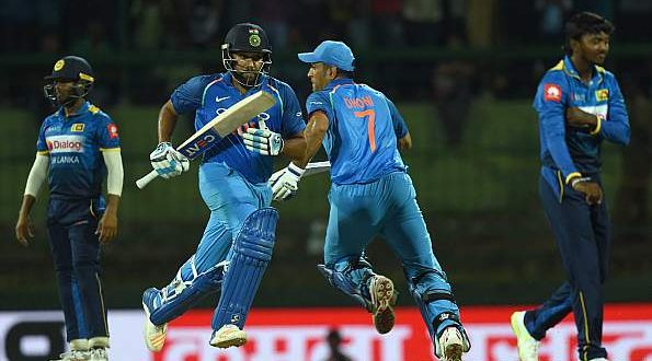 Dhoni-Rohit spearhead India's dominance; Bumrah's five, icing on cake